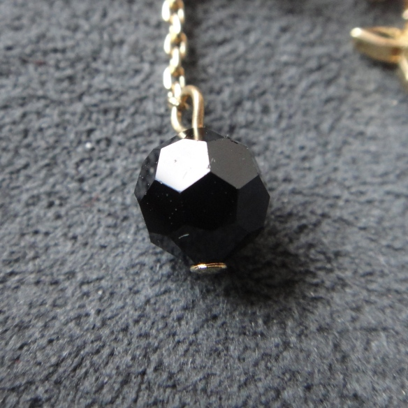 Louis Vuitton faceted black pearl