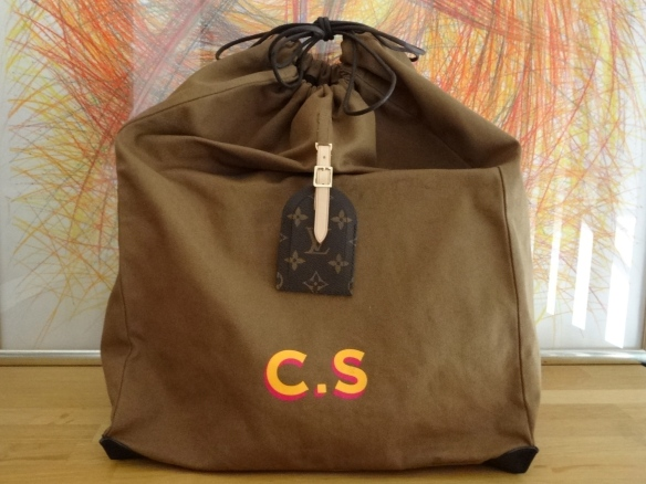 special dust bag  with CS logo and Monogram canvas luggage tag